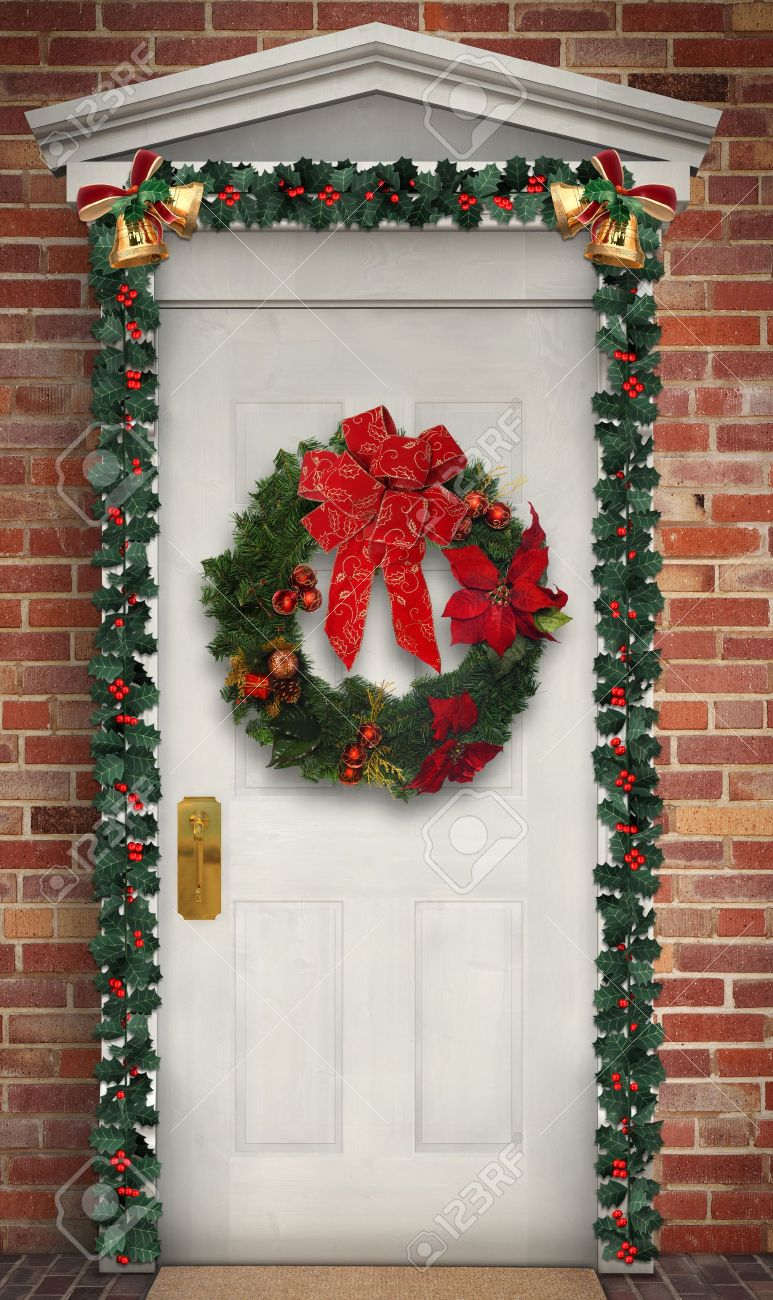 Superieur Christmas Wreath Hanging On A Traditional Wooden Door Decorated With A  Holly Garland Stock Photo