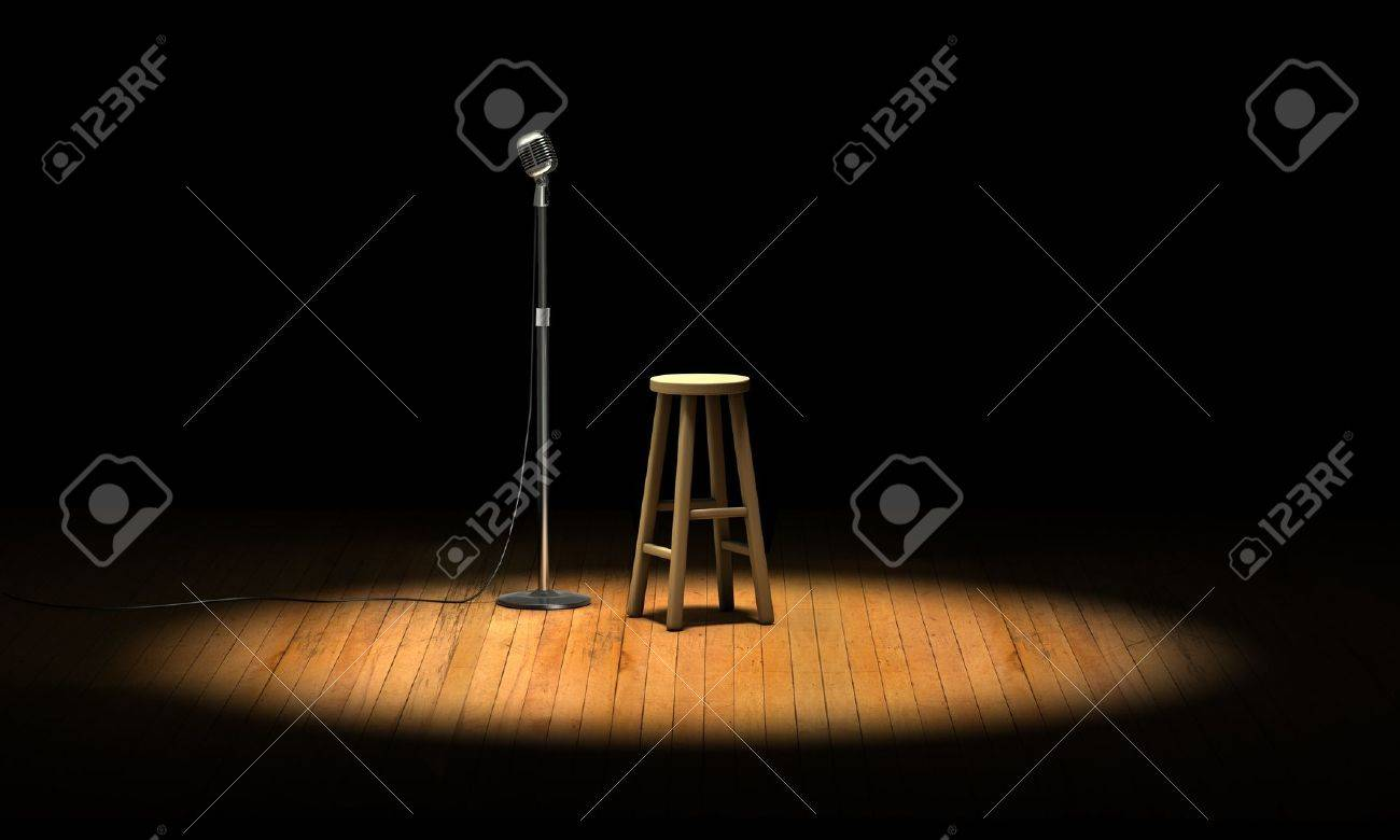 Microphone stand and wooden stool under a spotlight on a stage Stock Photo - 9524799