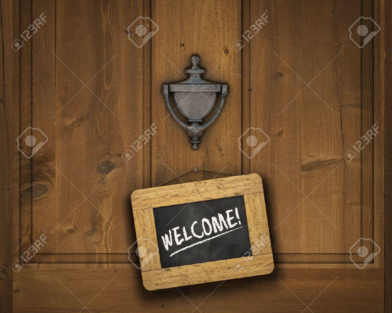 Small chalkboard hanging on a door underneath the door knocker with the word Stock Photo - 9524503