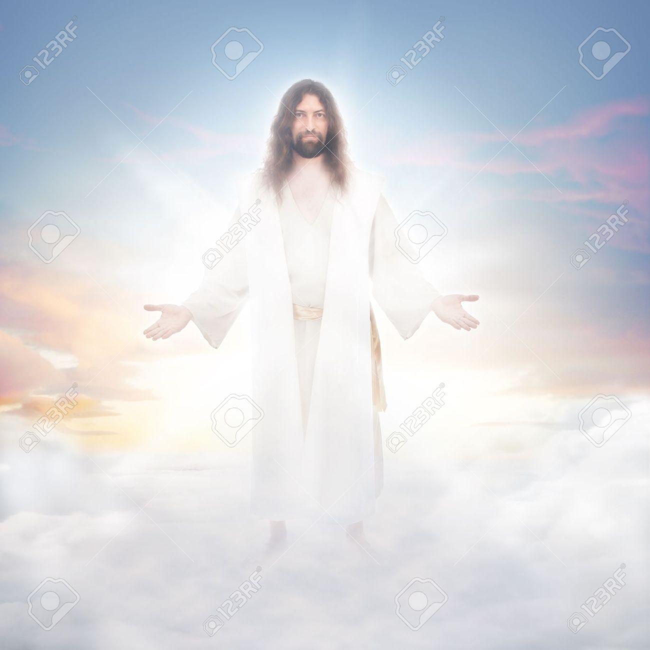 jesus resurrected in heavenly clouds bathed in luminous light stock