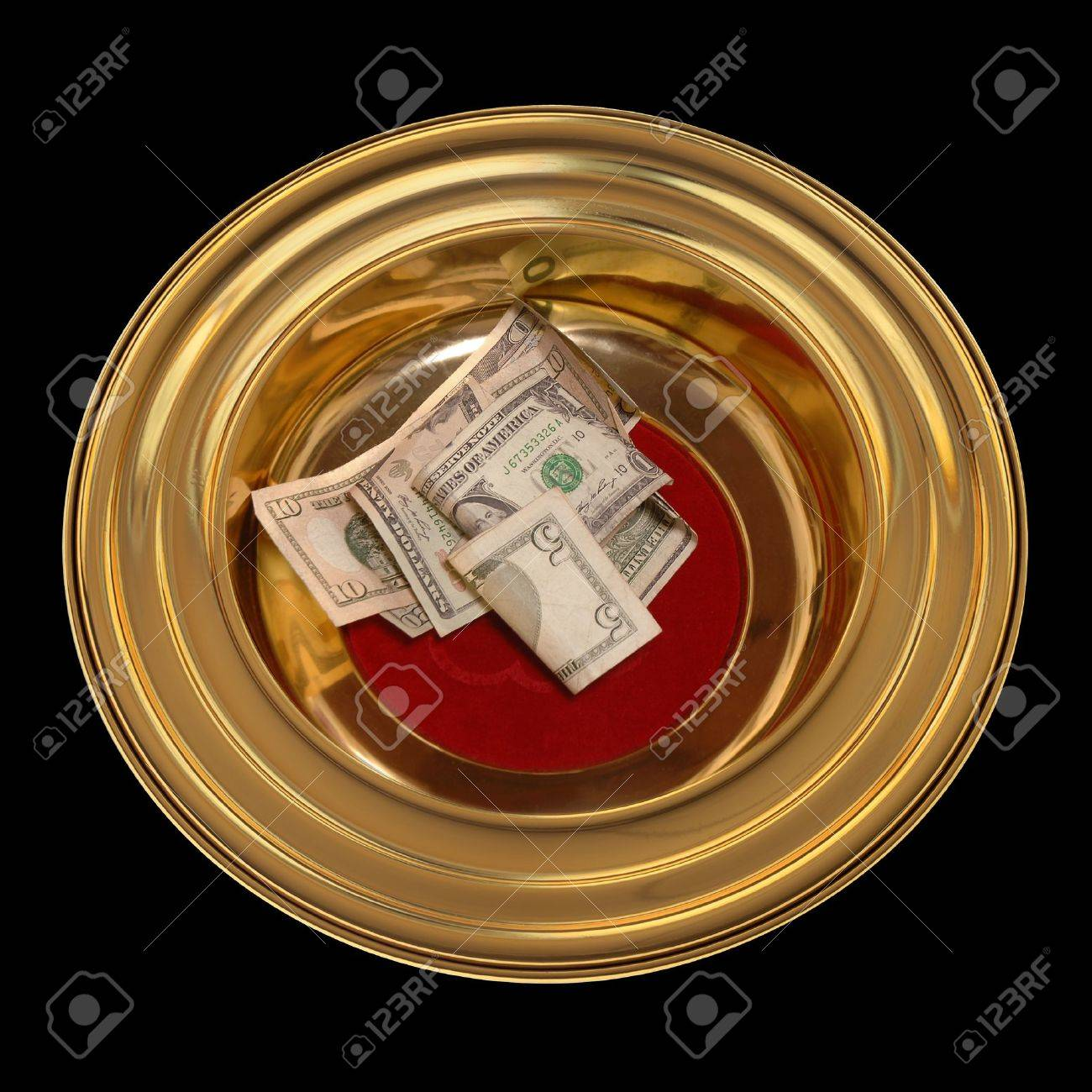 Church offering plate with some currency in it Stock Photo - 15440283