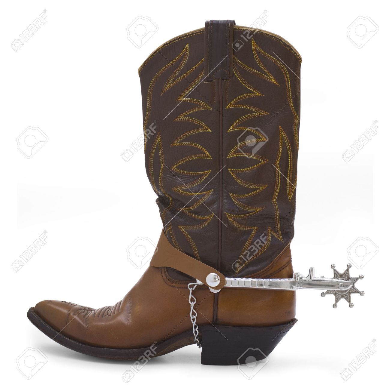 Side view of a brown cowboy boot and silver spur on a white background. Stock Photo - 15442294