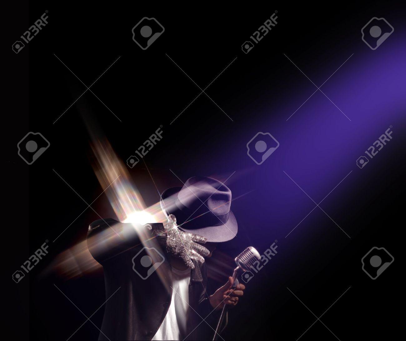 Spotlight shining down on a Michael Jackson impersonator performing. Stock Photo - 15442327