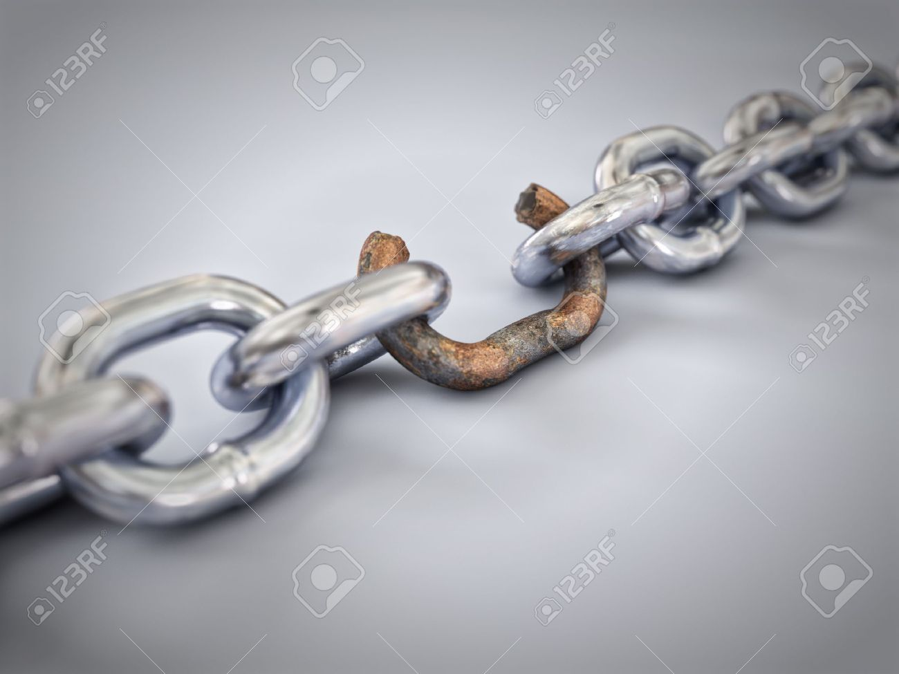 A chain with a broken link highlighted red to highlight the weak link. Stock Photo - 16948319