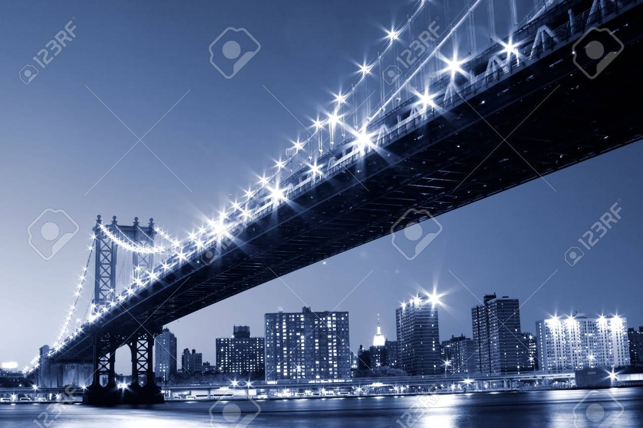 Manhattan Bridge and Manhattan skyline At Night Lights, NYC Stock Photo - 5501504