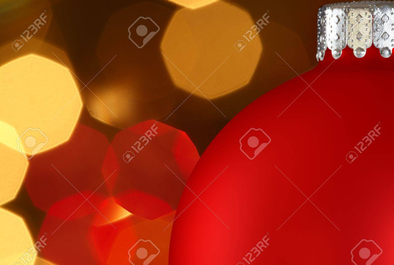 Blue Christmas Ornament Over Colorful Golden Red Christmas Lights Bokeh Background Stock Photo - 11550322