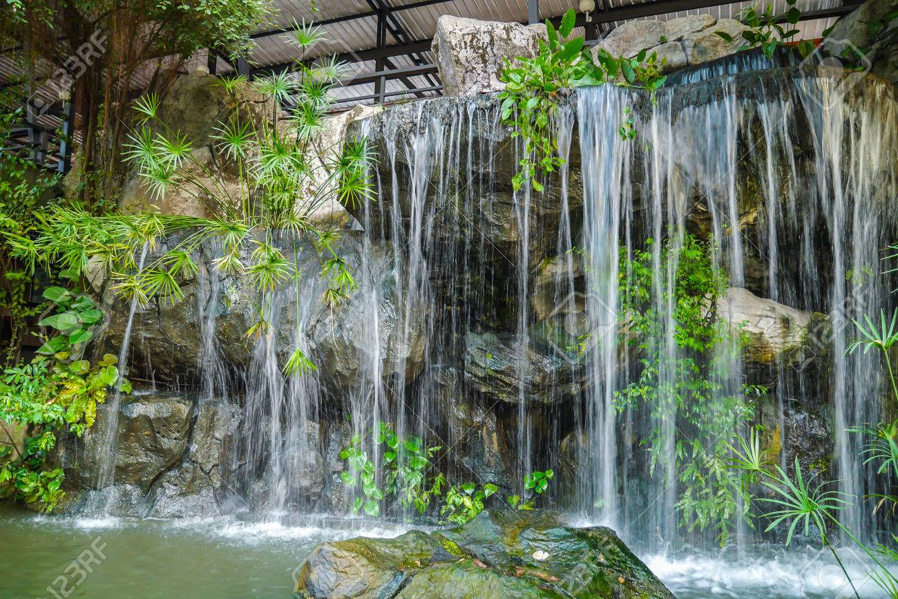 Decorative, landscaped waterfall in the home garden Stock Photo - 24461612