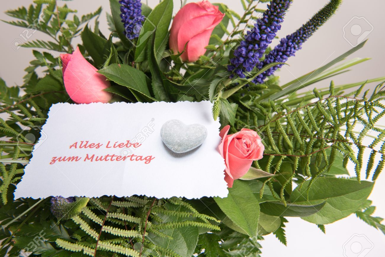 Bouquet Of Flowers With Card All The Best In German Stock Photo