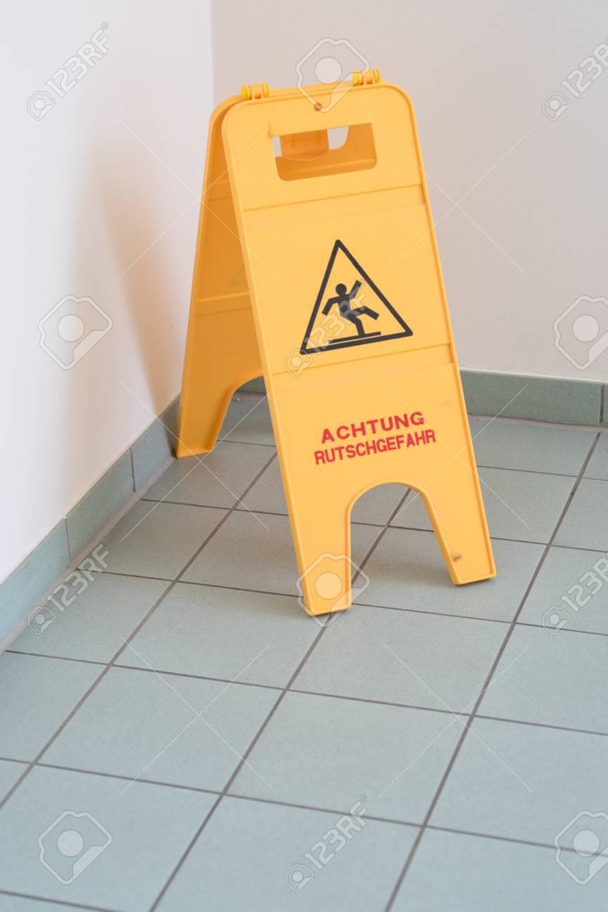 Slippery tile floor columbialabelsfo sign for slippery tile floor indoors danger stock photo picture dailygadgetfo Gallery