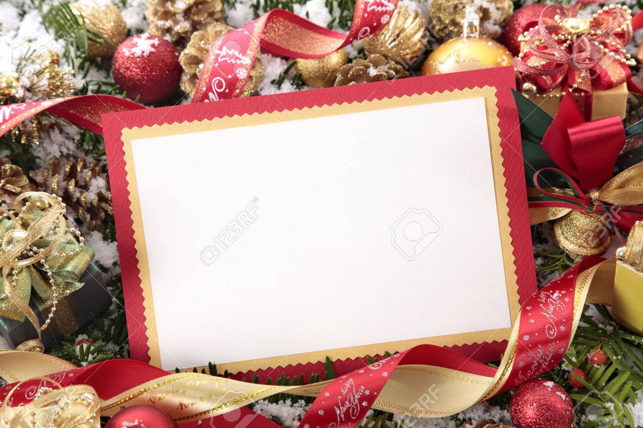 Blank Christmas card or invitation with red envelope surrounded by decorations. Space for copy. - 47473095