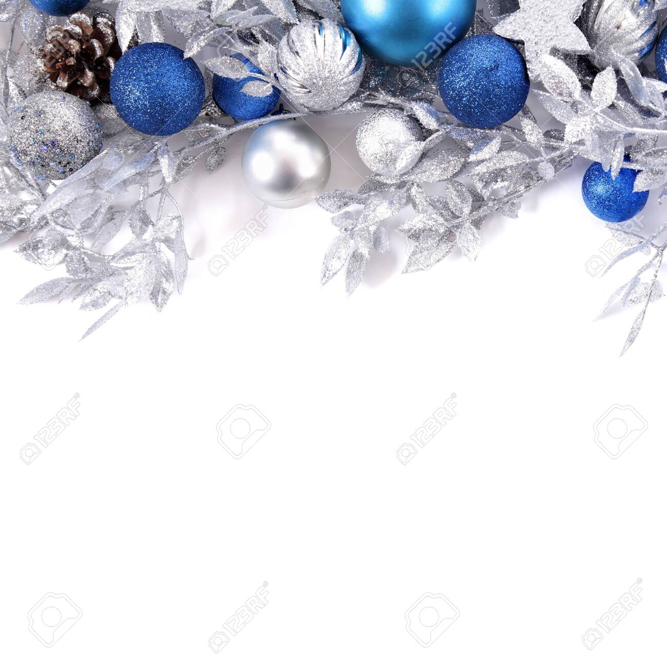 Christmas border with blue and silver decorations square - 121005574