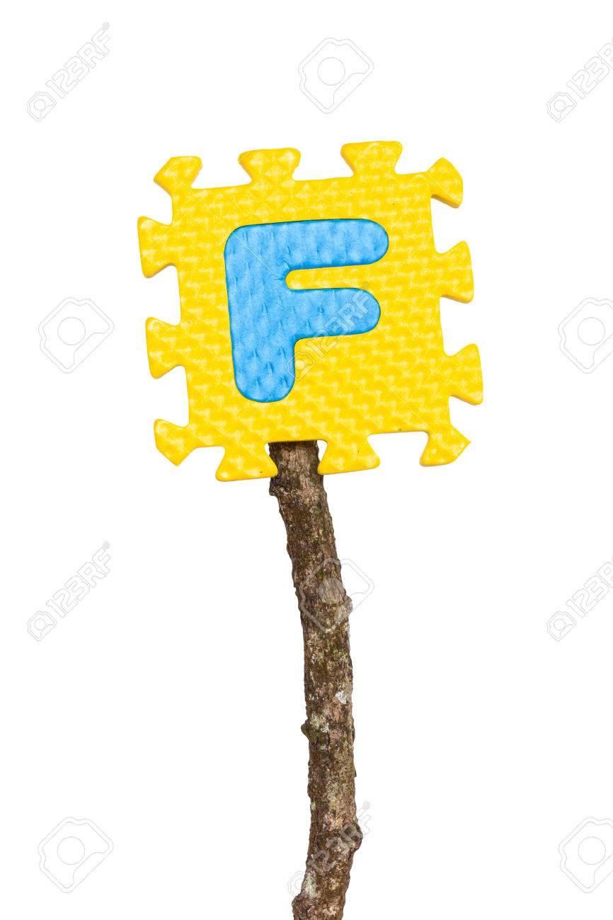 Rubber alphabet F isolated on white background Stock Photo - 25914608