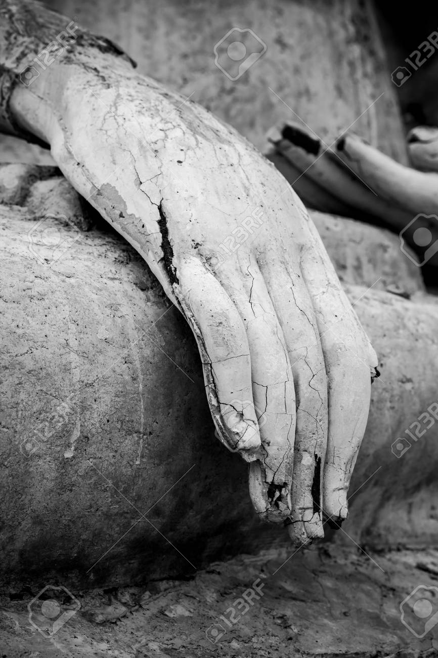 Closeup of the fingers of a Buddha statue Stock Photo - 26294000