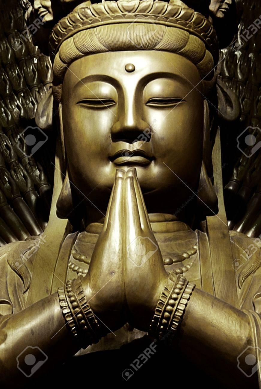 Golden statue of Guan Yin (goddess) - 13621045-Golden-statue-of-Guan-Yin-Stock-Photo-goddess