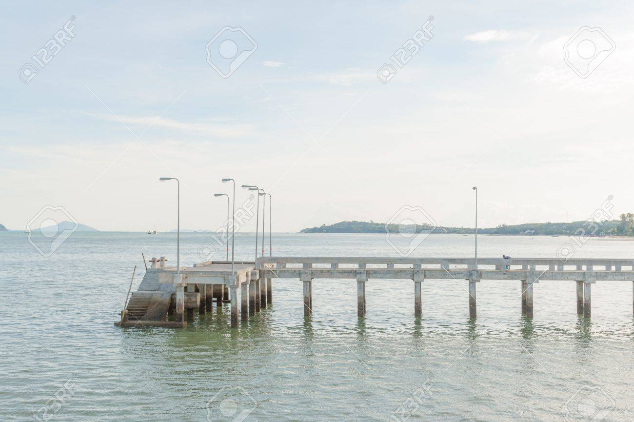 Concrete walk bridge across the sea with the cloudy sky at chalong pier, phuket Thailand Stock Photo - 16739416