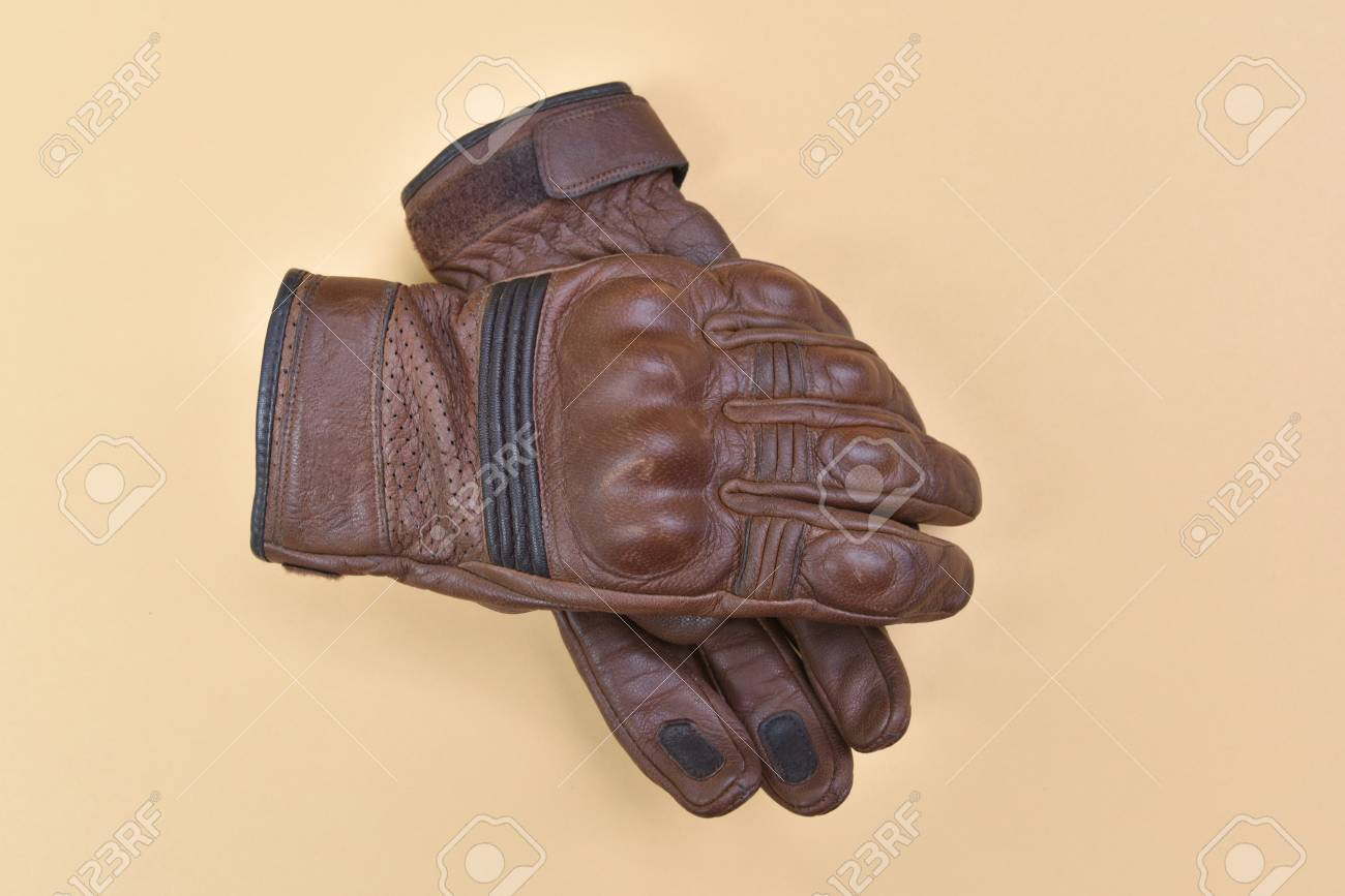 bb9637ed9f28c Stock Photo - Tan brown leather gloves for riding a motorcycle or bicycle