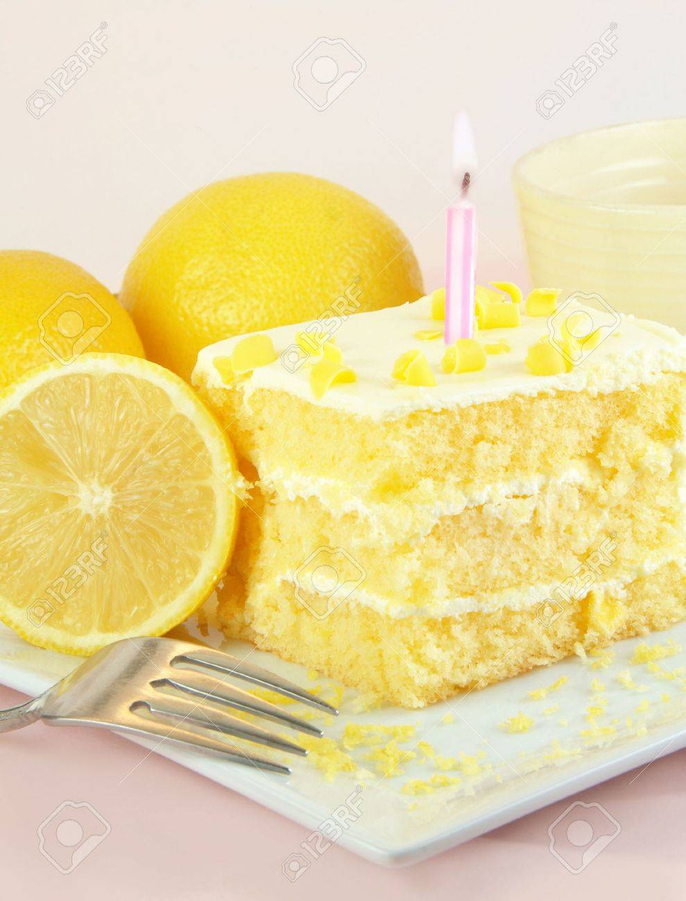 Lemon Birthday Cake With One Lit Candle Lemons And Fork On