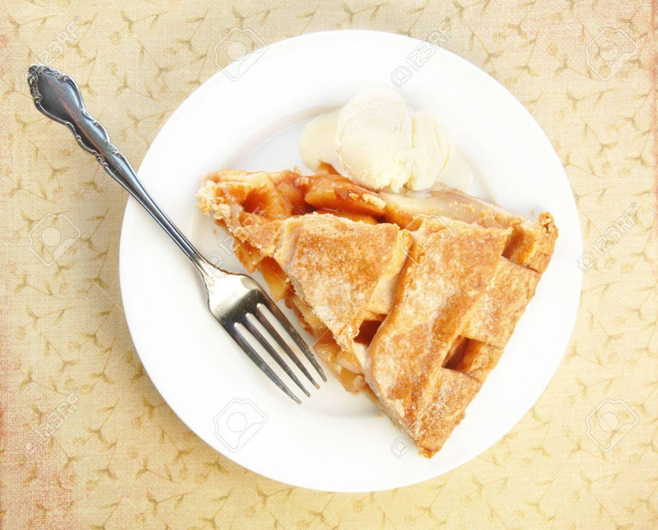 Lattice top apple pie slice with ice cream and fork. Stock Photo - 4782225