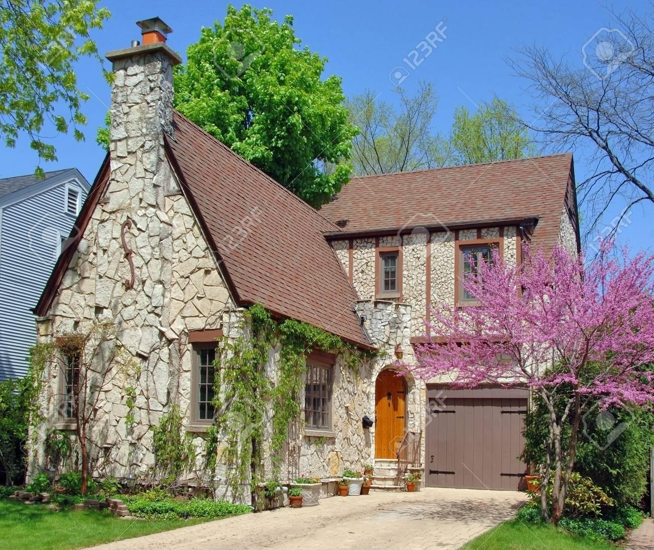 Stone house in a peaceful suburban neighborhood. Springtime. Stock Photo - 4874098