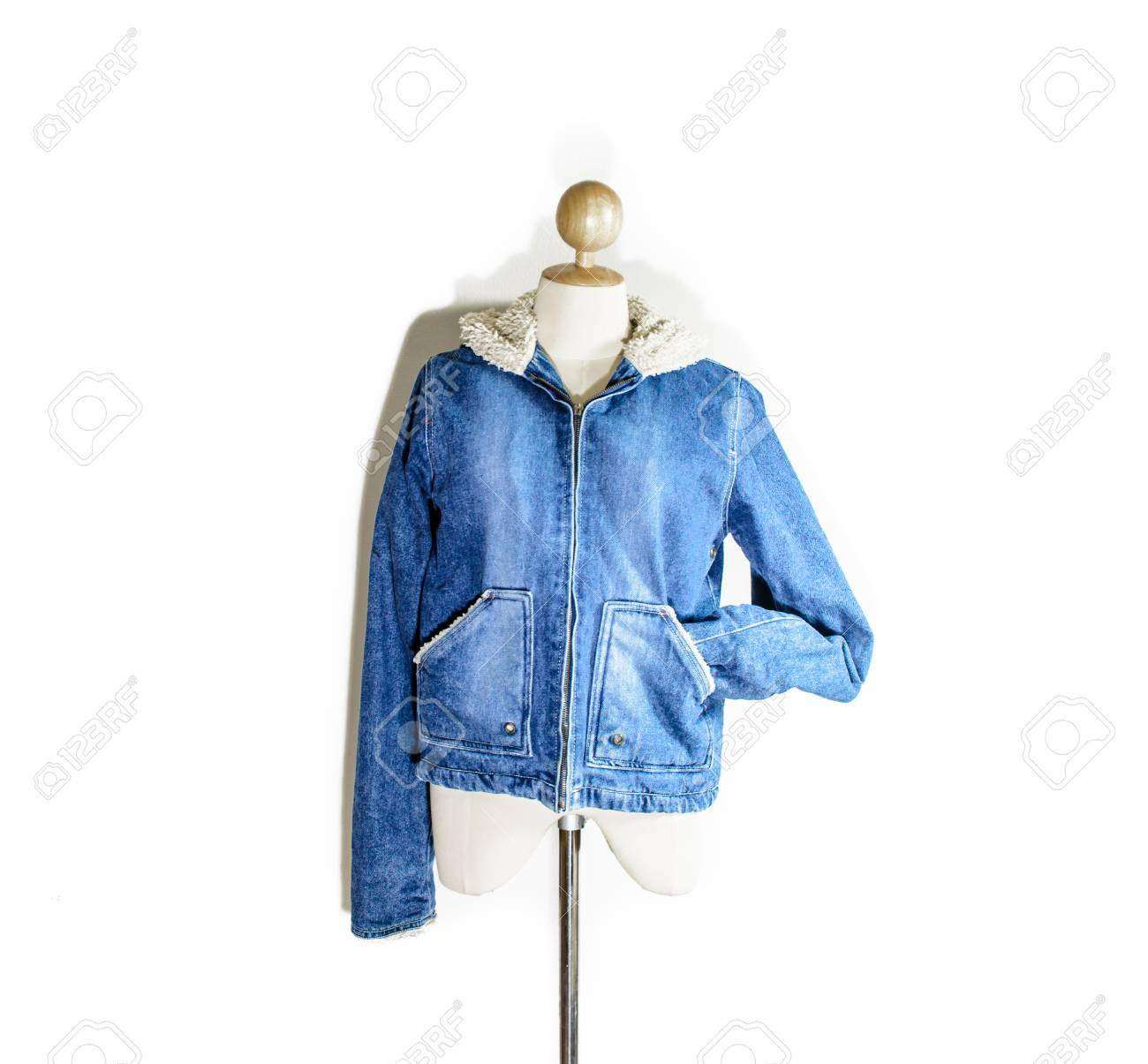 single old vintage blue jean coat at white dummy shirt with drop shadow isolated on white backgroound Stock Photo - 22851822