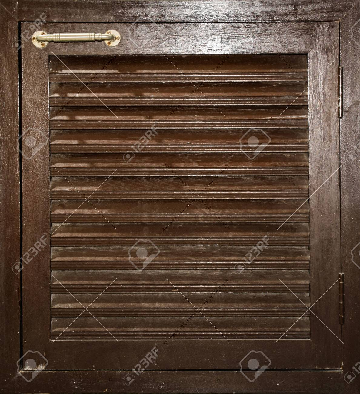 Old Deep Brown Tone Wood Cabinet Door With Steel Holder Stock ...