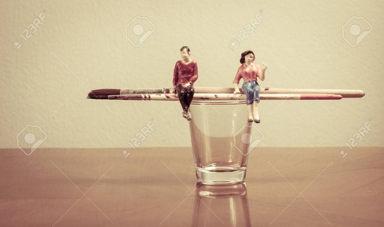 Miniature People Sitting On Paint Brush Concept Painting Tool