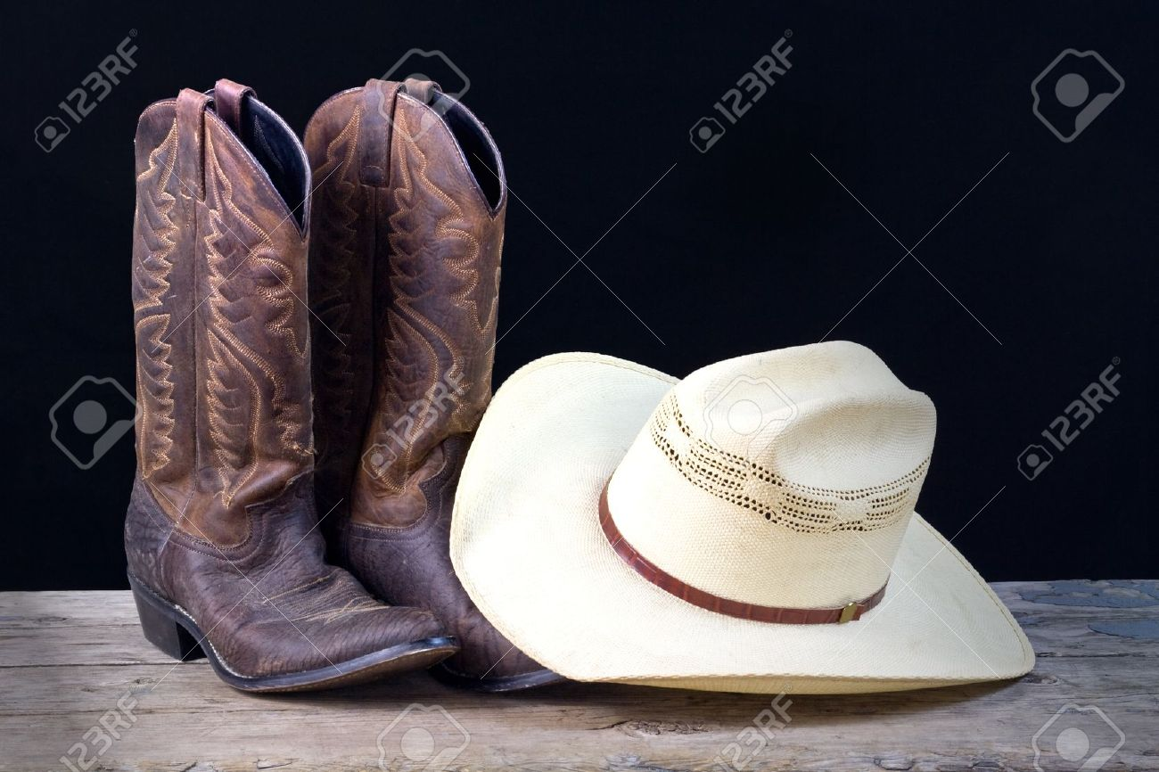 cowboy boots and cowboy hat on wood floor with black background Stock Photo  - 9783756 c43855f89b4