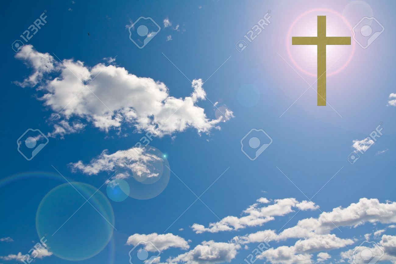 a Christian cross in a clouded sky with sun flare behind it Stock Photo - 10348977