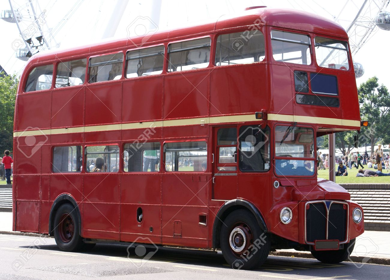 London Bus with faint outline of the London Eye in the Background Stock Photo - 1438061