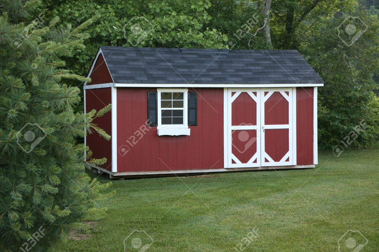 Lawn storage shed in a landscaped area Stock Photo - 5405610