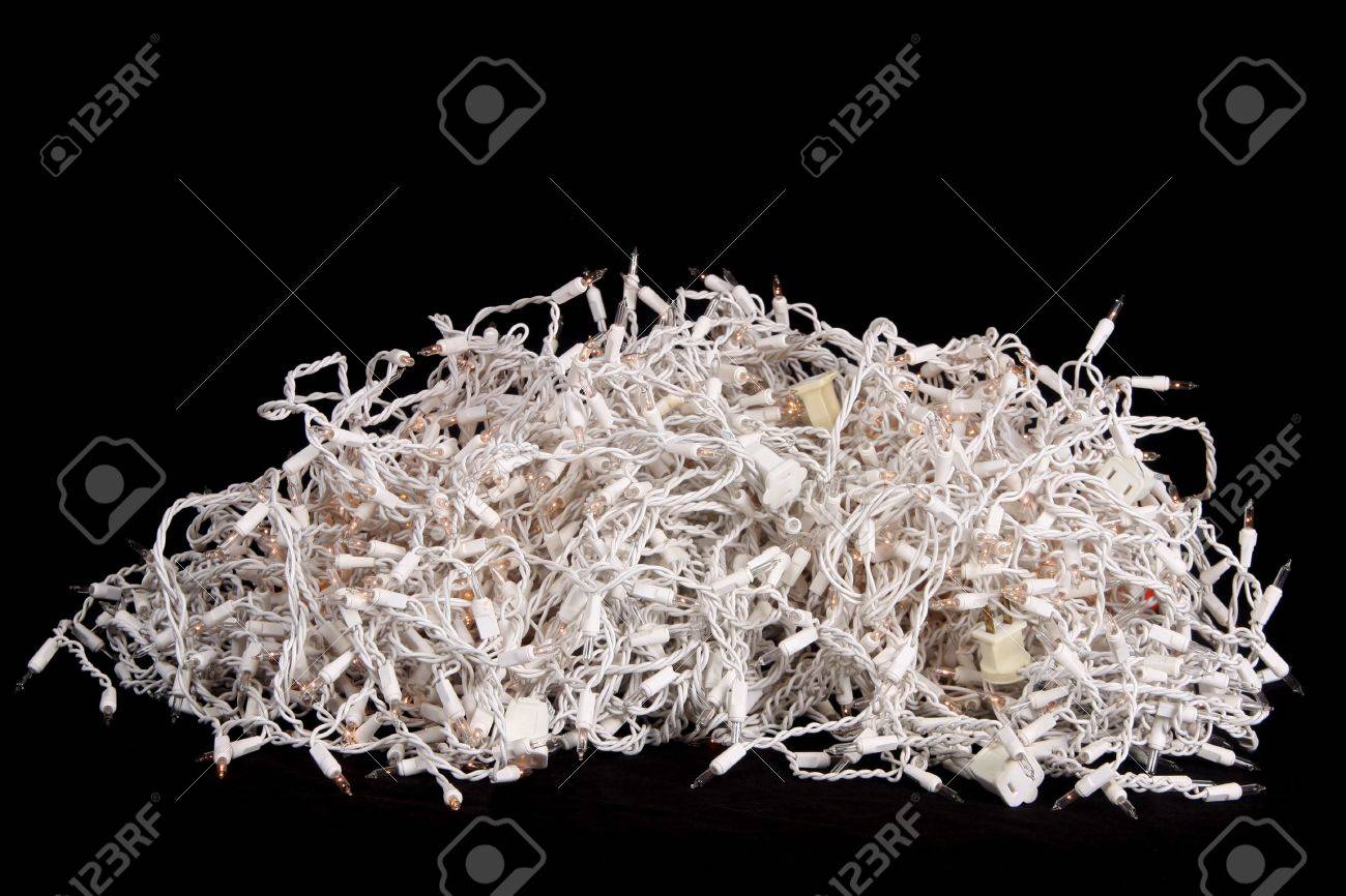 Pile of tangled Christmas tree lights set against a black background Stock Photo - 5708871