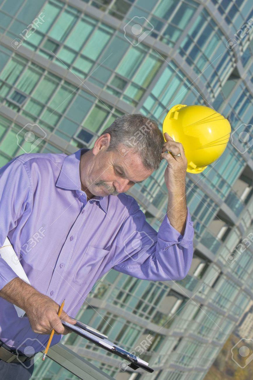 Architect solving problem Stock Photo - 7136777