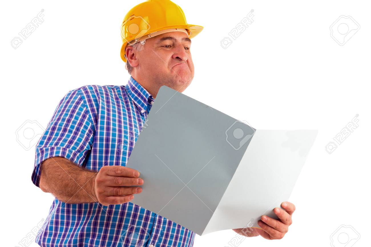 expressive engineer looking at plans isolated on white Stock Photo - 15739787