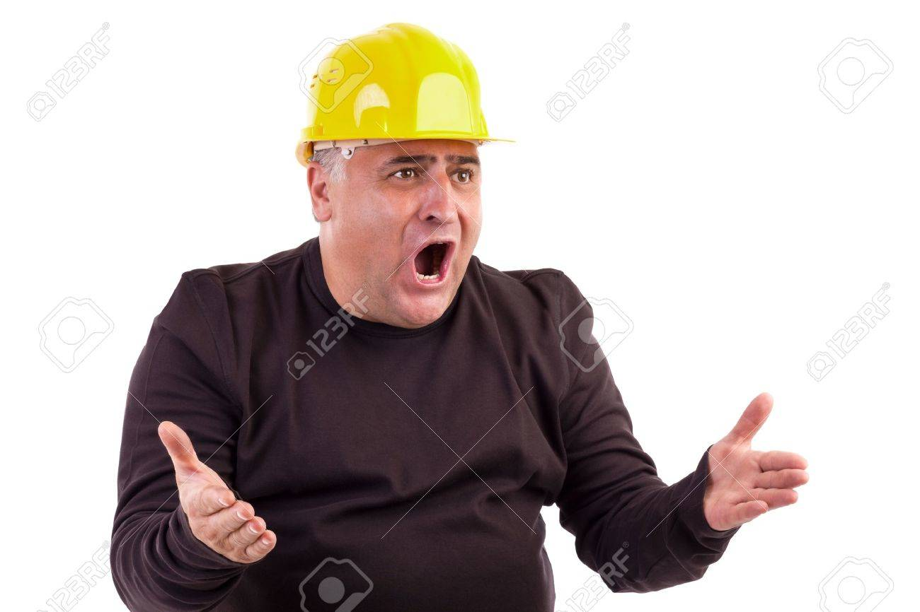 Angry construction worker looking at something isolated on white background Stock Photo - 16305593
