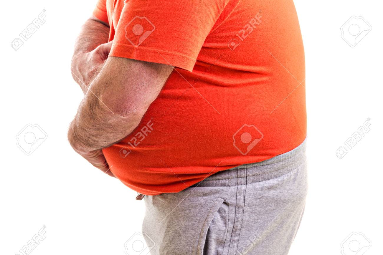 Man holding both hands on his aching stomach, closeup, isolated on white Stock Photo - 22612064