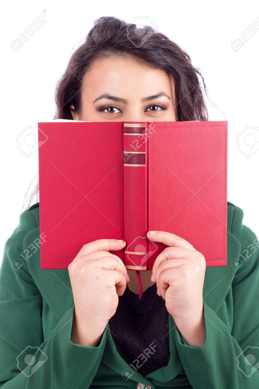 Portrait Of A Beautiful Young Woman Holding A Book In Front Of