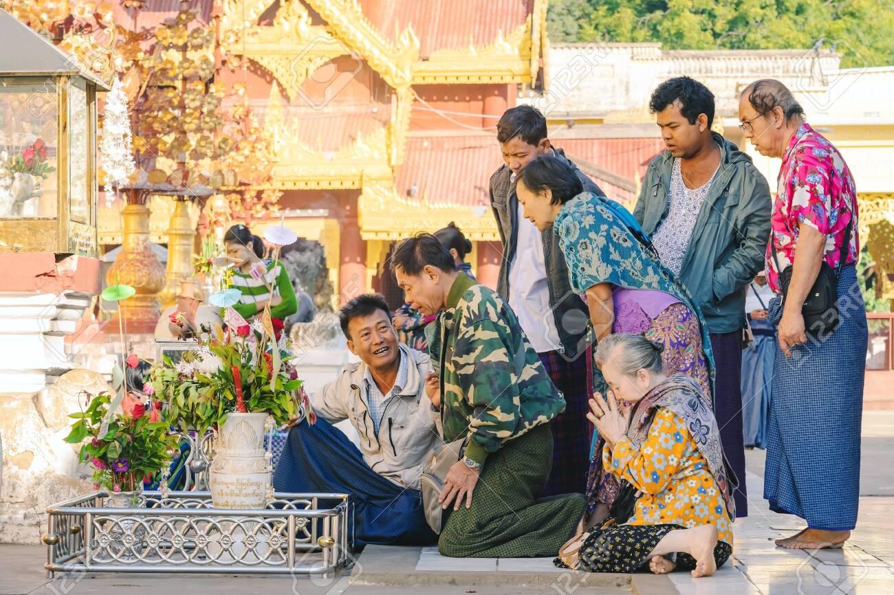 BAGAN-Myanmar, January 21, 2019 : Unidentified tourists make merit and photographing at Shwezigon Pagoda on january 21,2019 in Bagan, Myanmar. - 135435352