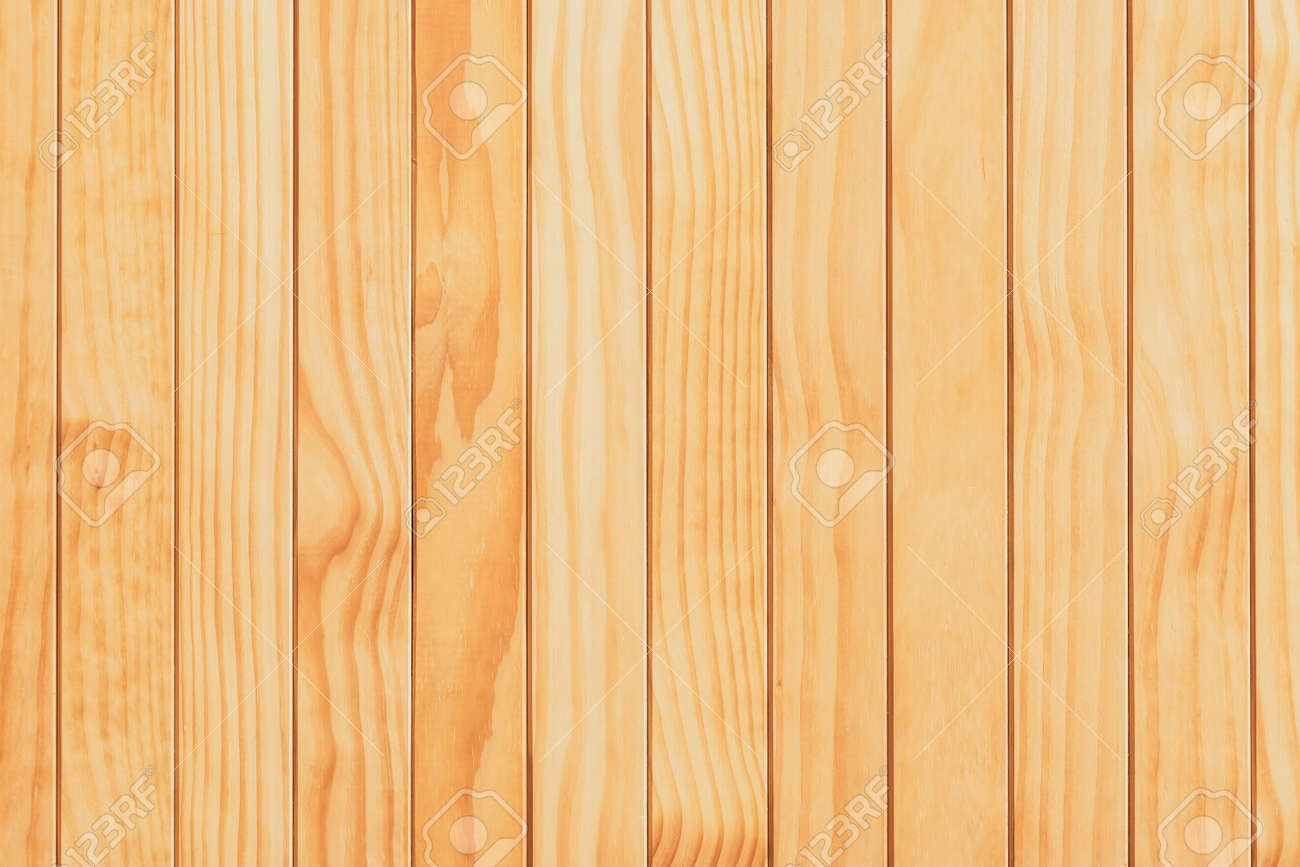 Natural wooden surface made from kiln-dried boards useful as background for design and decoration. Wood material backdrop for wallpaper. Soft brown wooden use for products or texts showing display. - 168987297