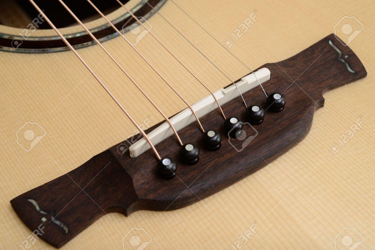 Guitar Bridge Saddle And Pin Of Acoustic Guitar Stock Photo