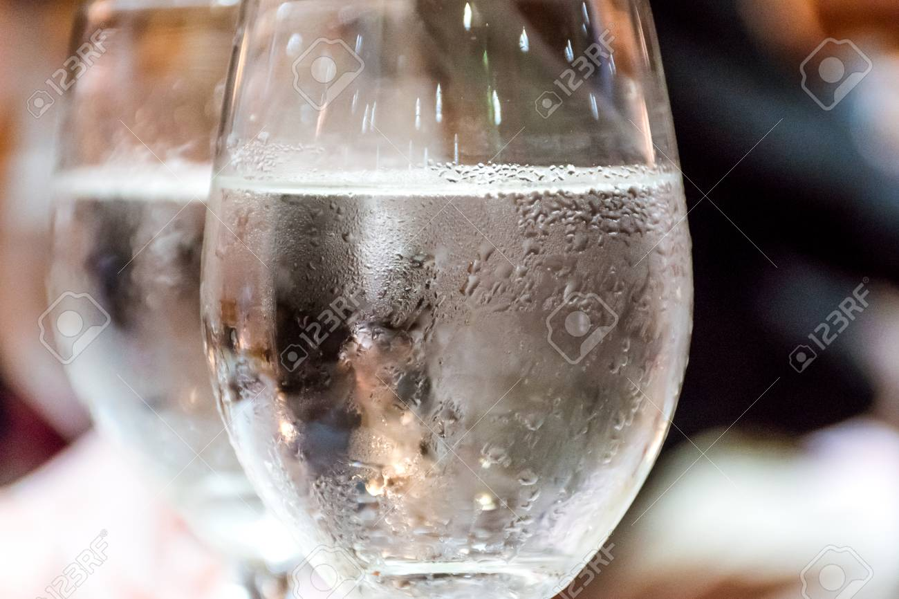 Closeup Of Drinking Water And Ice With Droplet In Glass On - Restaurant glass table tops