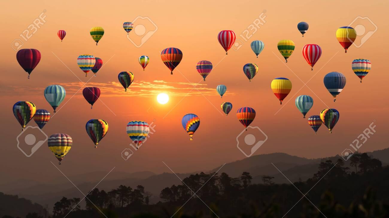 Hot air balloon above high mountain at sunset - 131183966