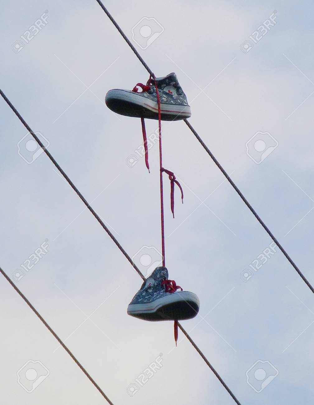Photo Of A Pair Of Old Sneakers Hanging On The Wire Stock Photo ...