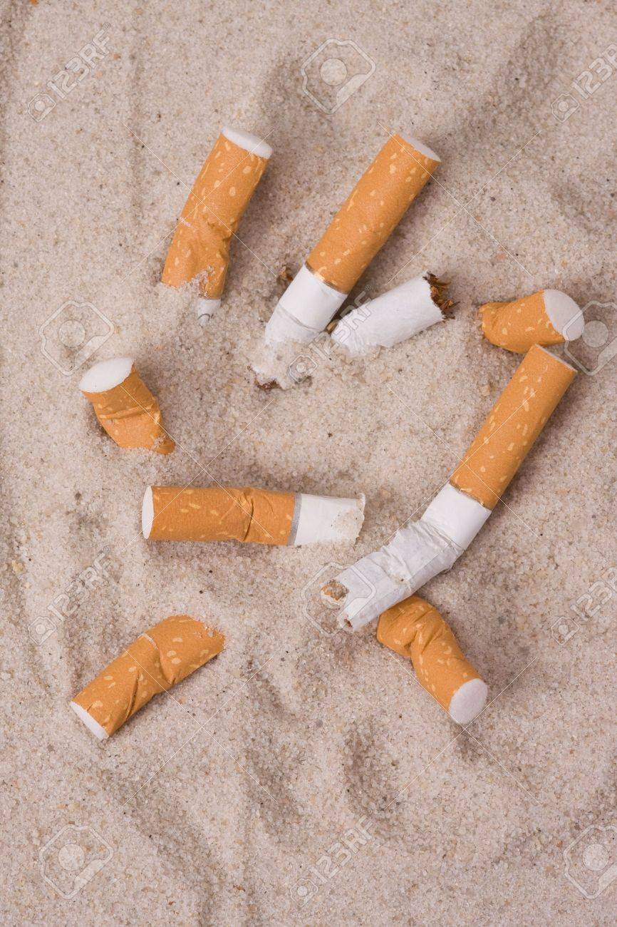 cigarettes in sand Stock Photo - 5050052