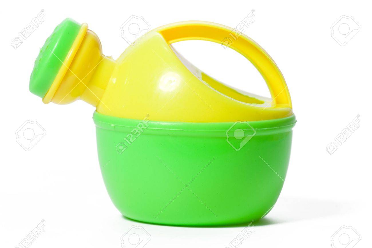 toy plastic watering can isolated on white Stock Photo - 5466152