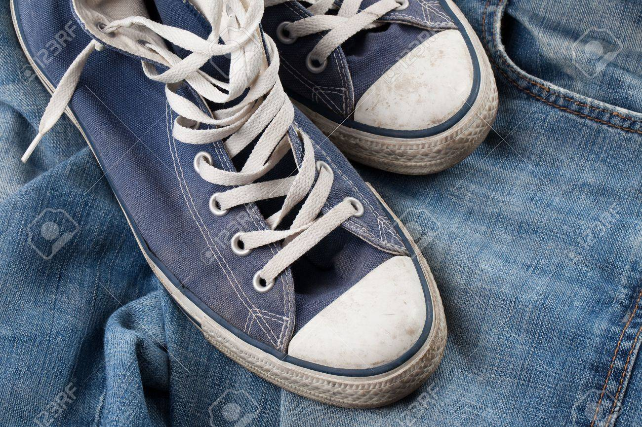 the old sneakers and blue jeans Stock Photo - 6158559