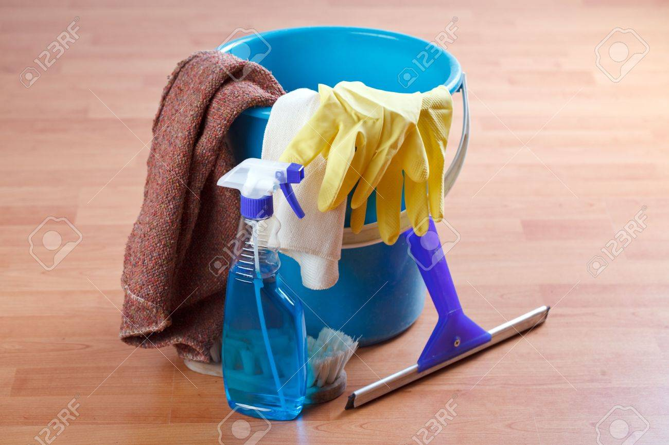 cleaning products on wooden floor - 6558435