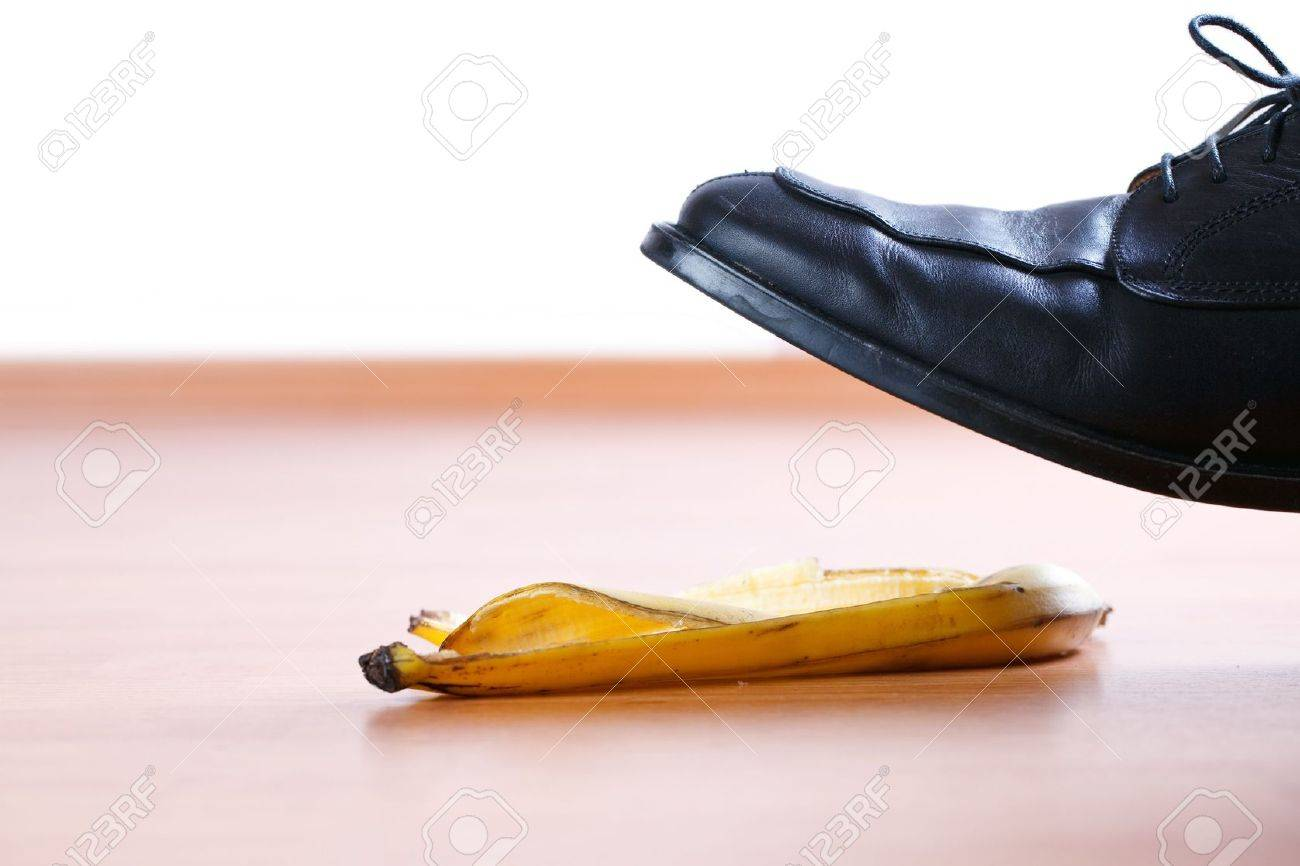 stepping on banana peel on wooden floor Stock Photo - 6558681