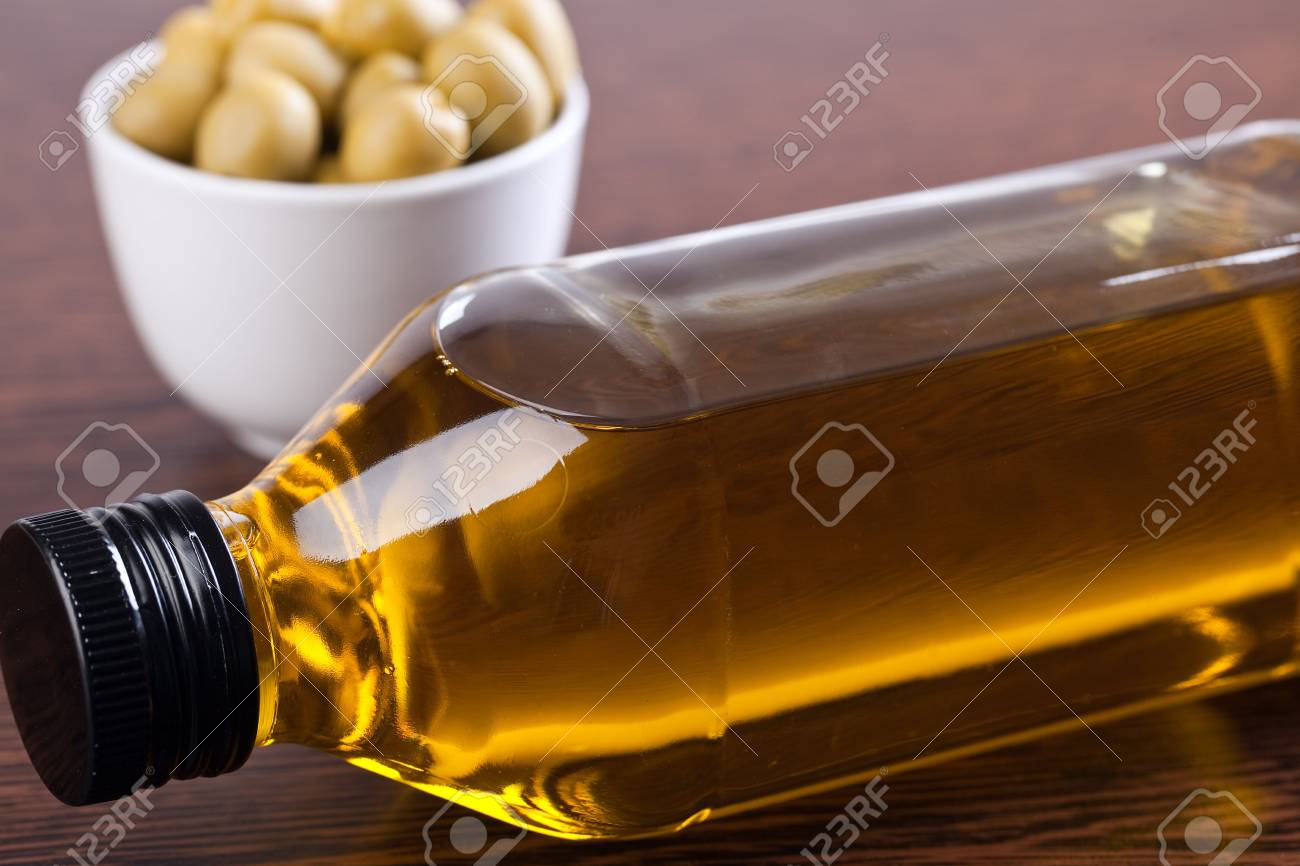 olives and olive oil on wooden table Stock Photo - 6741312