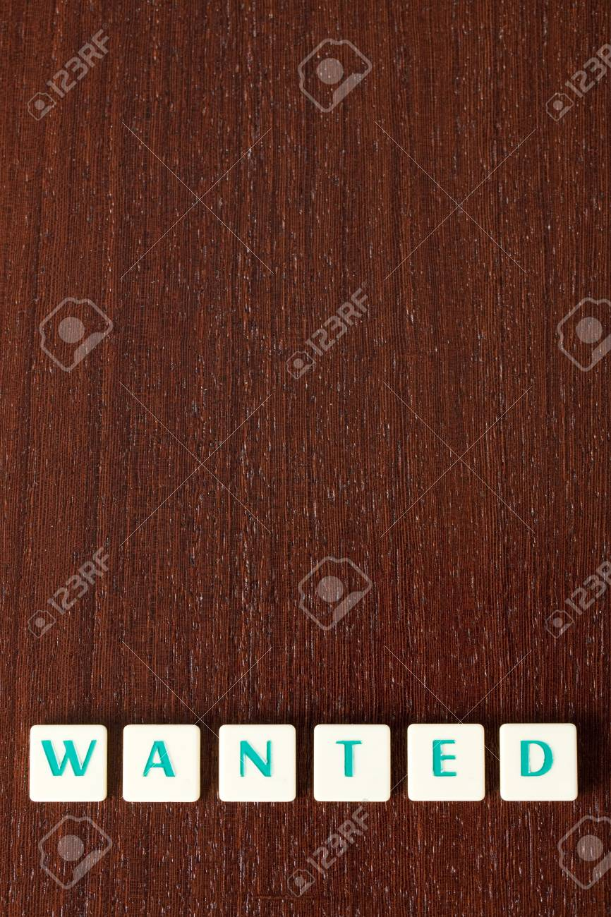 sign wanted on wooden background Stock Photo - 6800781