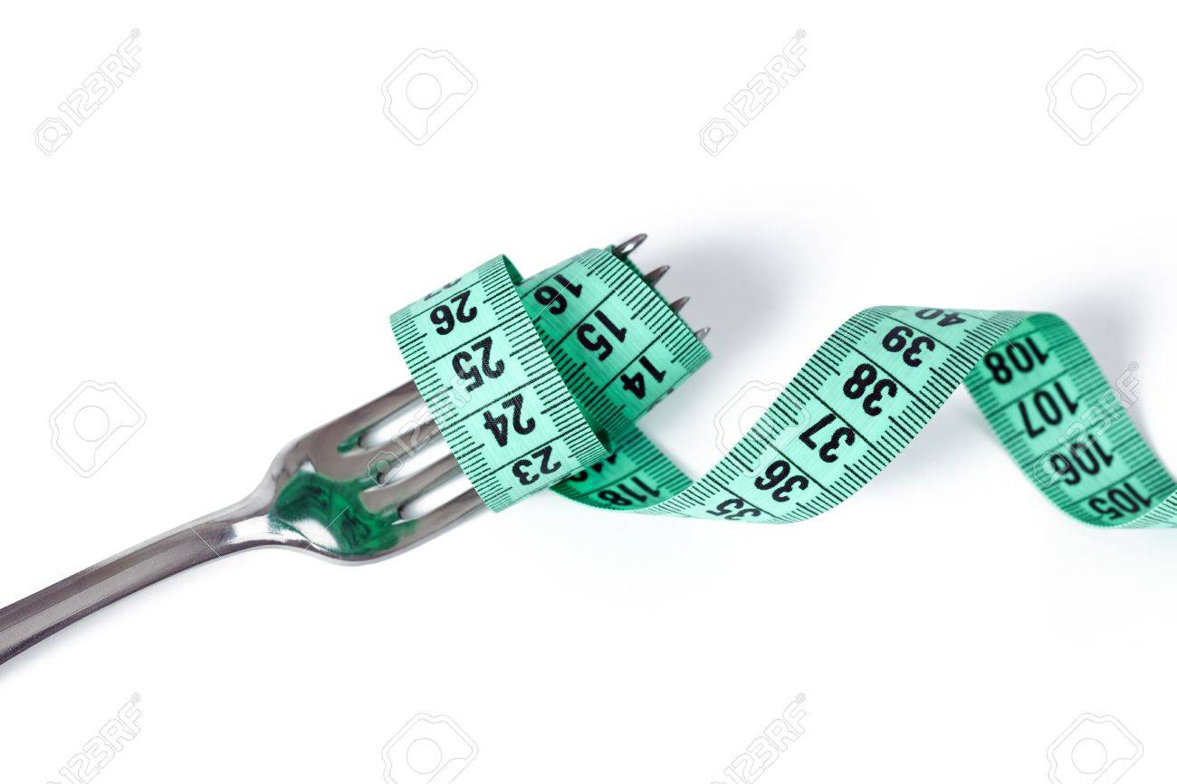 fork with measuring tape on white background Stock Photo - 6800724